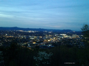 City in evening with lights illuminated