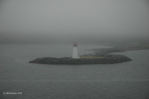Solitary lighthouse in the fog.