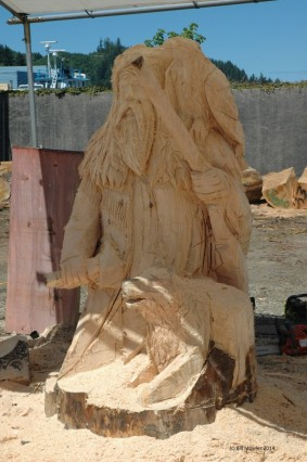 Mountain Man carved with chain saw.