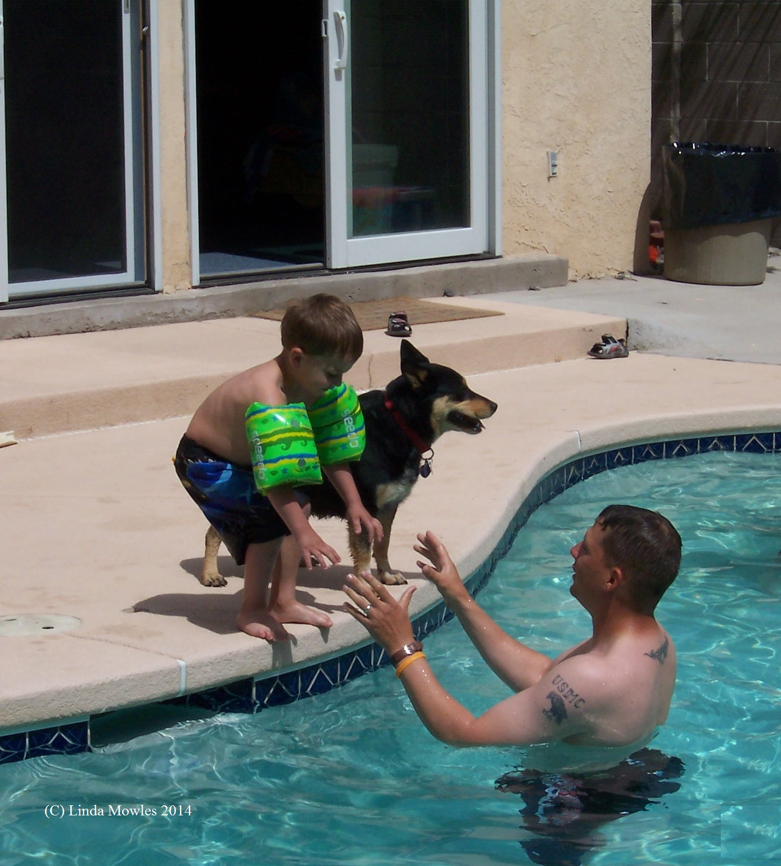 Helping child to swim (C)
