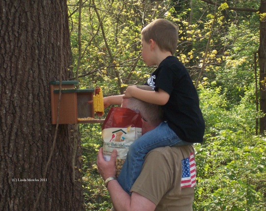 Helping child learn about feeding backyard friends