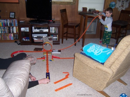 Papa and grandson playing hotwheels