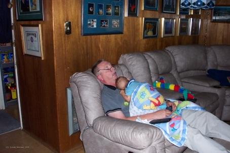 Grandfather and infant grandson resting together!