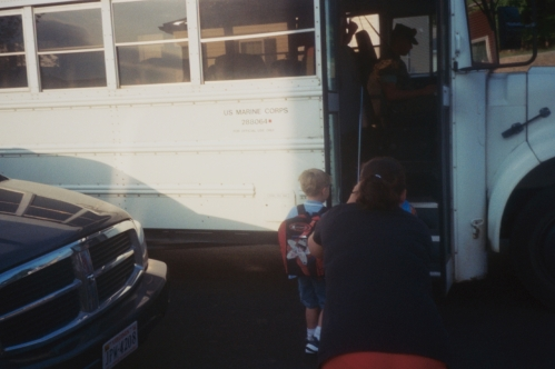 Boarding The Bus On The First Day Of Kindergarten.