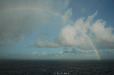 Rainbow in the sky after the storm on the ocean