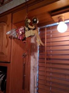 Wind chimes in kitchen window