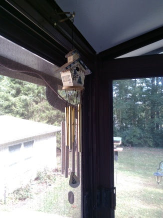 Wind chimes with brass chimes on porch