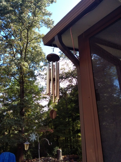 Wind chimes playing music outside the porch