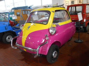 A BMW Isetta at the Lane Motor Museum. You get into the car by opening the front of the vehicle.