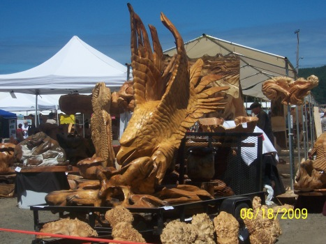 Eagle grasping at salmon, carved by chain saw sculptor.