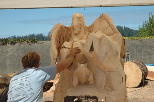 Checking the sculpture and confirming what the craftsman sees for his piece.