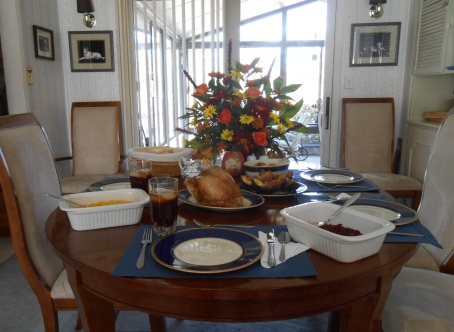 The Thanksgiving Day meal table set for celebration.