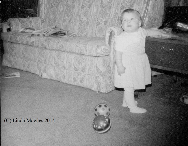 Baby Liz standing at table (C)
