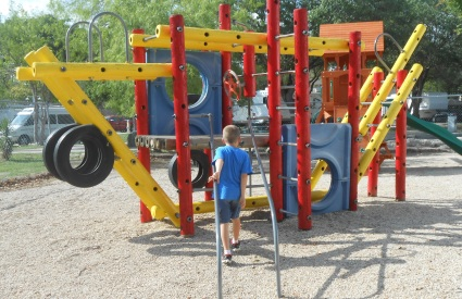 child at playground gym