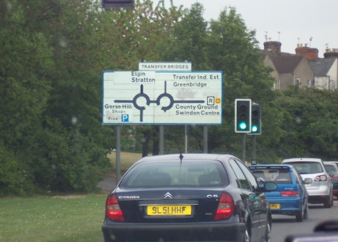Road signs in England with two roundabouts