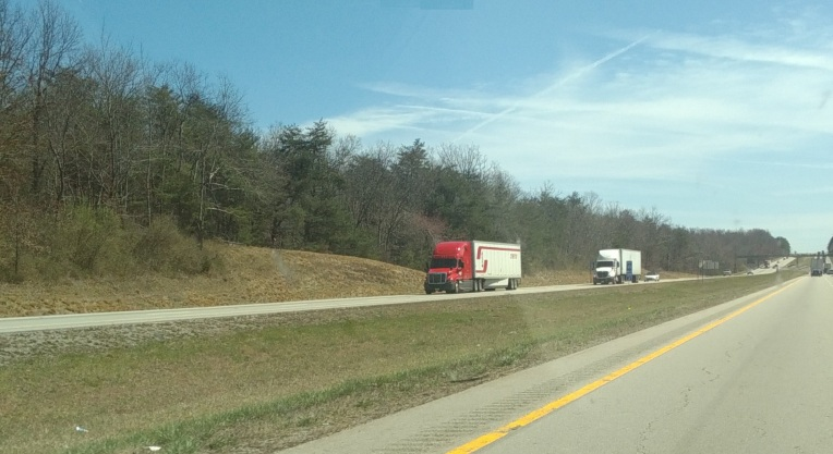 Trucks along interstate (C)