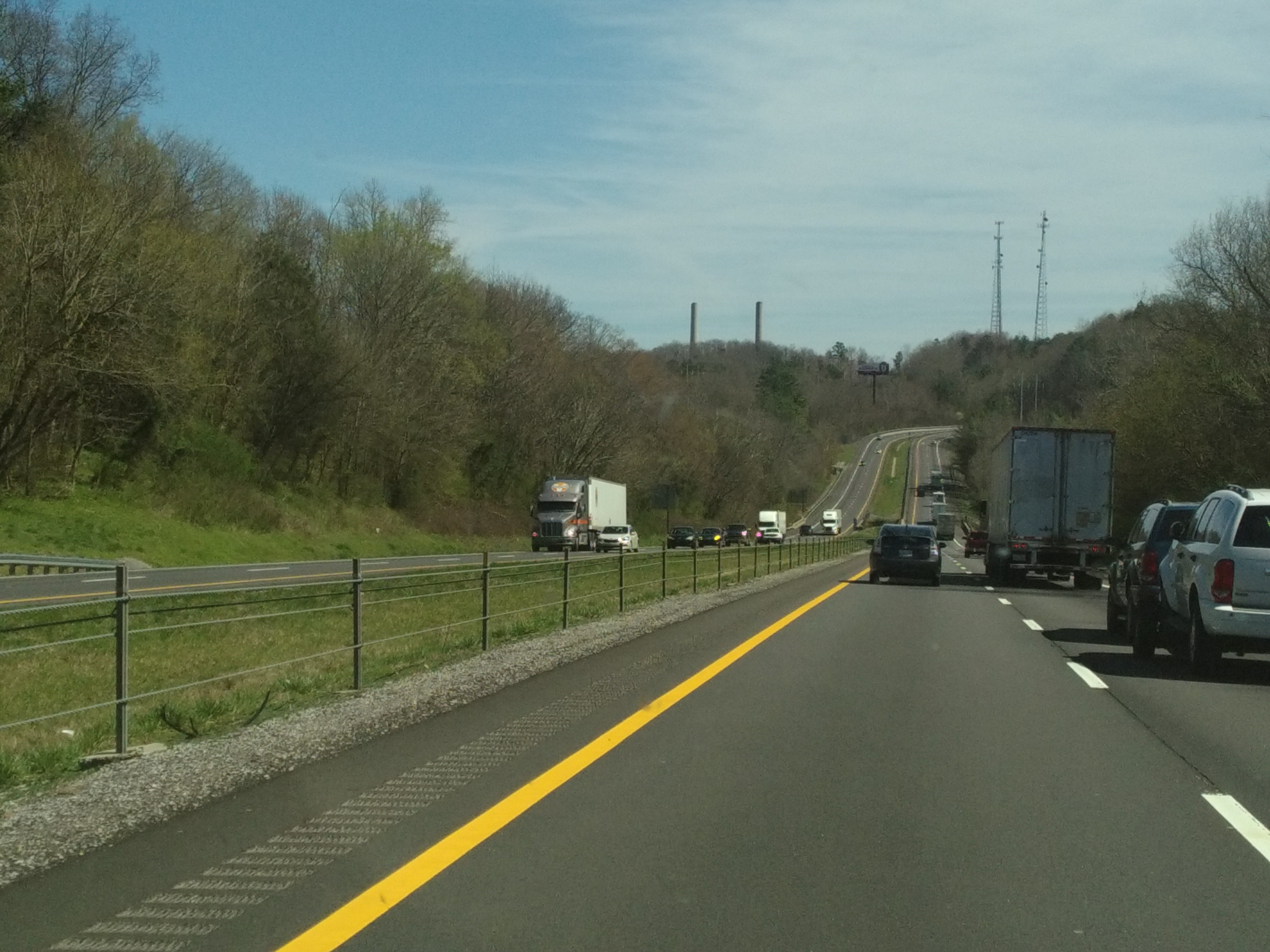 Trucks going up and down hills on interstate outside Knoxville (C)