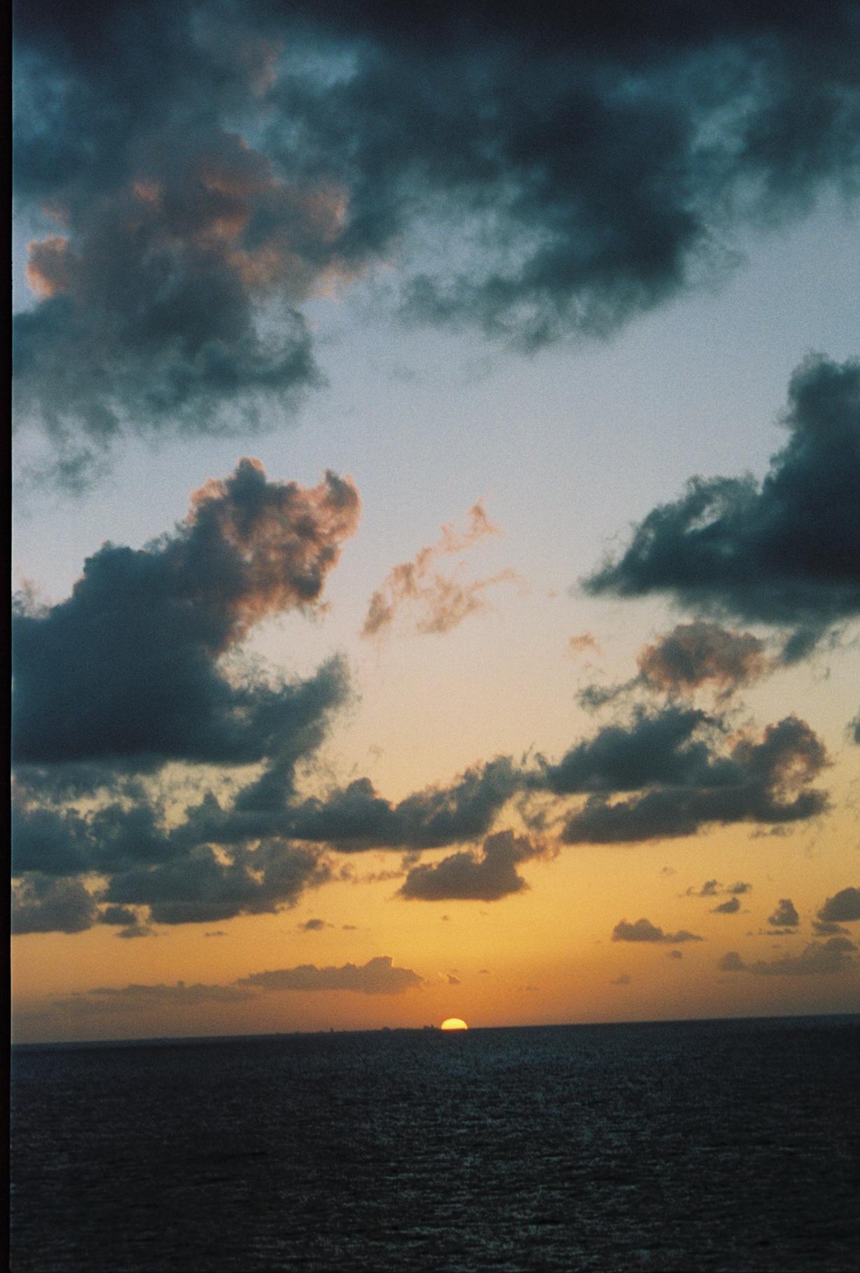 Ocean verticle sun going down