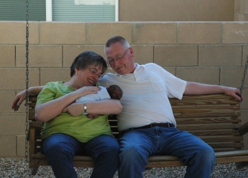 Grandparents holding baby