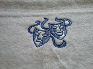 Theater Masks on towel