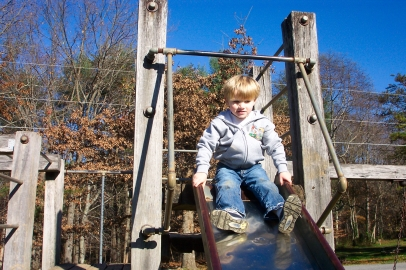 Boy on slide at playground