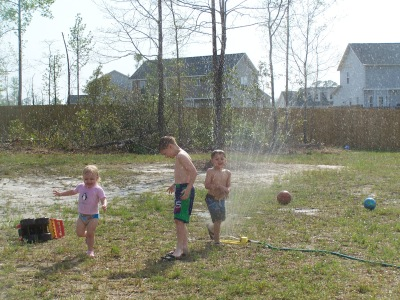 playing in sprinkler