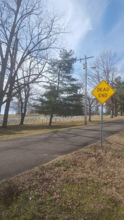 dead end sign and cemetery